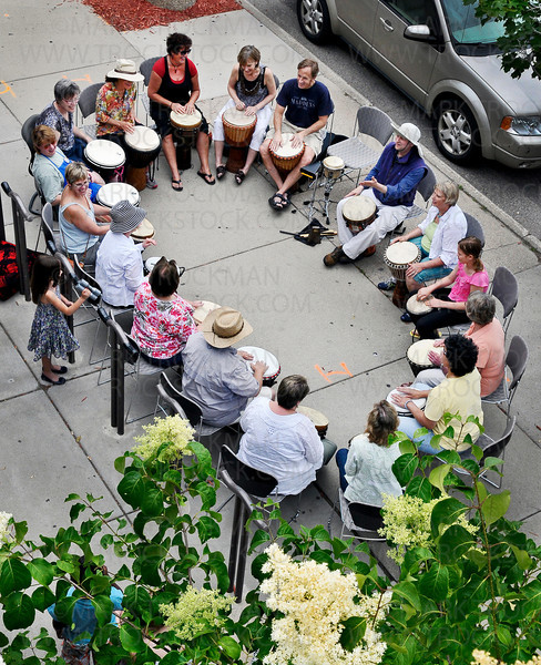 A drum circle, led by author and African drumming instructor Alan Dworsky, right, in purple, greeted visitors to the 'Happy 100th: Then, Today, Tomorrow': A celebration of the Hopkins Library's 100th birthday with tales of the Dow House and ghosts, photo displays, contests and local authors.