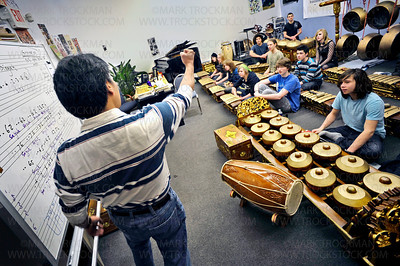Indonesian Sumunar Music & Dance, Gamelan Director Joko Sutrisno, left, engages his Main Street School students through conversation and physical hints Thursday, Mar. 10, in Hopkins.  Joko is at the school as a two-week guest artist and instructor.