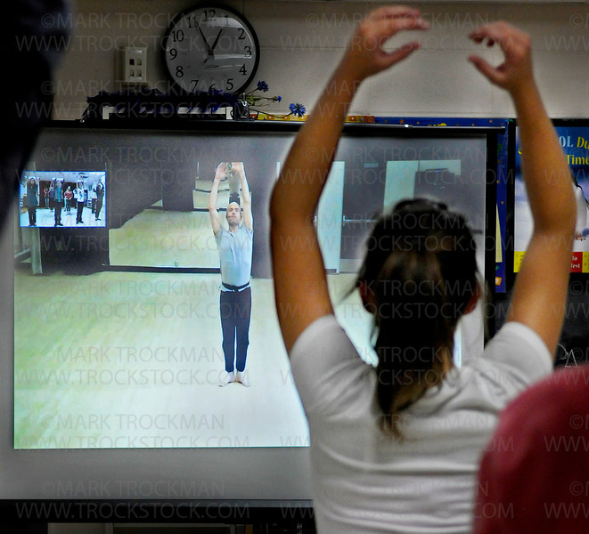 Cowles Center for Dance and the Performing Arts choreographer Mathew Janczewski, center, leads Drama teacher Danielle Pittel's class in a modern dance exercise utilizing a two-way interactive, real-time teaching environment Wednesday, Oct. 26, at Minnetonka Middle School East.