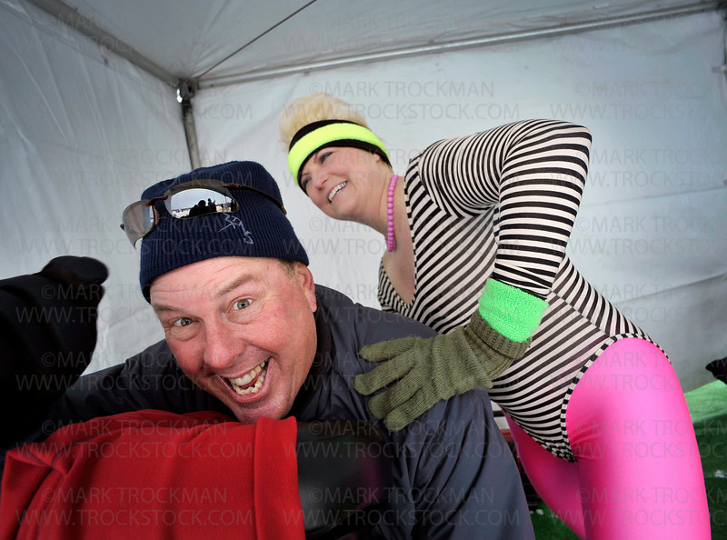 Cathrine Krull, St. Louis Park, a licensed massage therapist, gives golf pro Scott Spence, Rhode Island, a massage while dressed as a 1980's aerobic instructor during the 27th annual Chilly Open on Wayzata Bay on Lake Minnetonka Saturday, Feb 12.