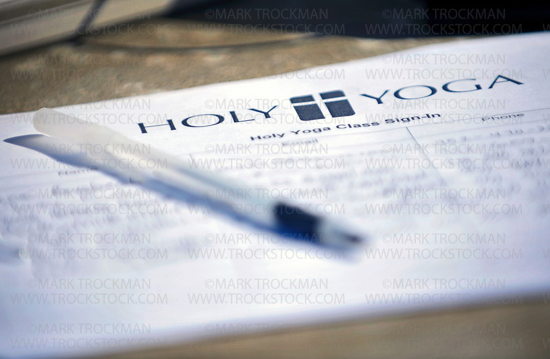 A sign in sheet for the Holy Yoga in the Park class on a table at Freeman Park in Shorewood Friday, July 21.  The class meets every Friday from July 8 through the month of August from 9:00 am until 10:00 am.