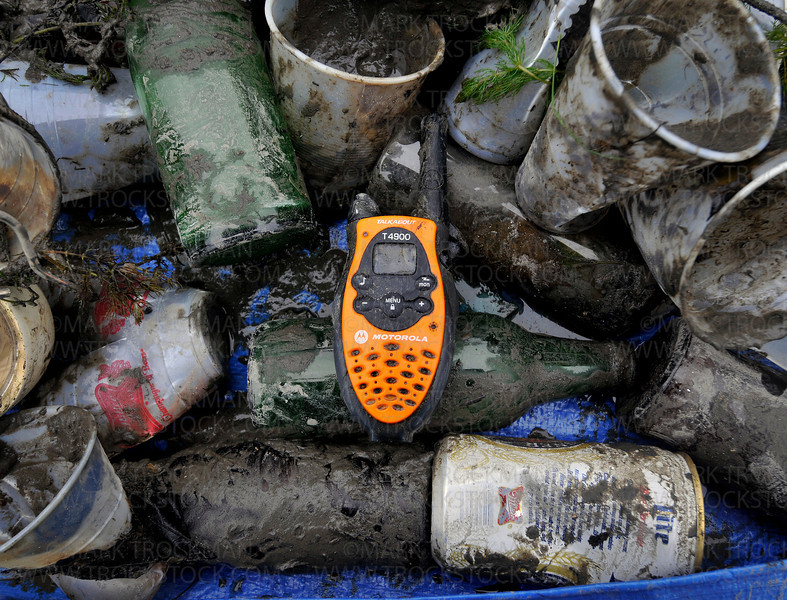 A two-way radio sits among other trash brought up from under the water by the team Muck Divers Connection at Bayside Grill Saturday, June 12, in Excelsior.  A total of about 60 SCUBA divers participated in the Lake Minnetonka Association's 9th Annual Clean Up.