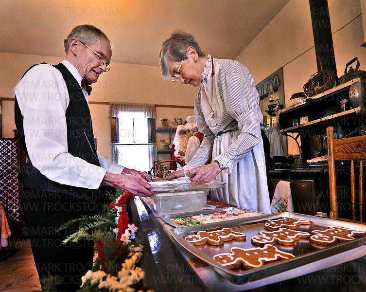 Plymouth Historical Society members Dennis and Betty Jacobson decorate holiday cookies on the second floor of the city's Historical Building Sunday, Dec. 2 at Plymouth Creek Park.  The Jacobsons were playing their part during Plymouth's 'Old Fashioned Christmas', Sunday, Dec. 2, at Plymouth Creek Park.