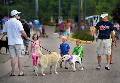 A meeting of the minds.  Dogs and their humans interact peacefully on Auditors Road in Mound's Harbor District Park Saturday, Aug. 13., during Dog Days Westonka.  Nearly 30 exhibitors lined the pedestrian-only road.