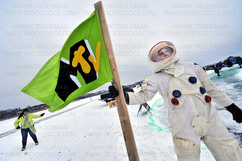 "Mtv Moonman Arlo Dissette, of Fazendin Realtors, holds a flag during the 29th annual Chilly Open Saturday, Feb. 9 on Wayzata Bay.  The event is a unique frozen golf event to celebrate our ""chilly"" winter season."