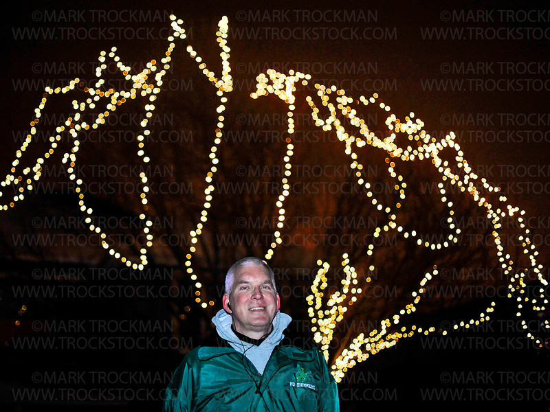 Mike Justak in front of his home in  Plymouth, Tuesday, Dec. 18, 2012.  Justak coordinates music to lighting up  his yard in a synchronized display that boggles the mind.