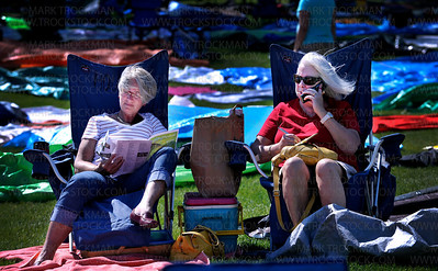 "Sandy Ohlsson, left, and Kathy House are, ""Friends forever,"" and have been, ""Coming to Music Fest forever.""  The two friends travel from Maple Plaine each year to enjoy the sun, the vibe, and the Music Fest crowd."