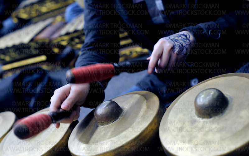 An Indonesian Sumunar instrument, called a Gamelan, is struck during a practice performance at Main Street School in Hopkins Thursday, Mar. 10, 2011.