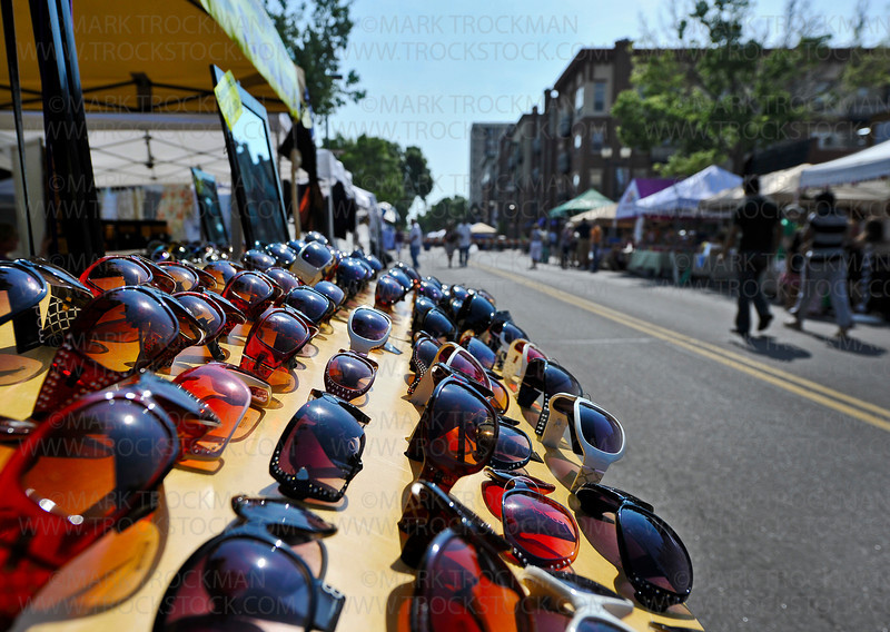 Mainstreet Days Arts and Craft Fair as seen from the Cheap Sunglasses tent Saturday, May 19, in Downtown Hopkins.  Mary Keogh, Shakopee, sells hundreds of sunglass varieties throughout the Midwest.