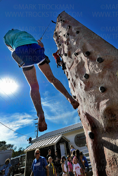 Mary Kozar, 9, Long Lake, rappels from the top of a large climbing pillar Saturday, Sept. 15, during the 13th annual Loretto Fun Fest.