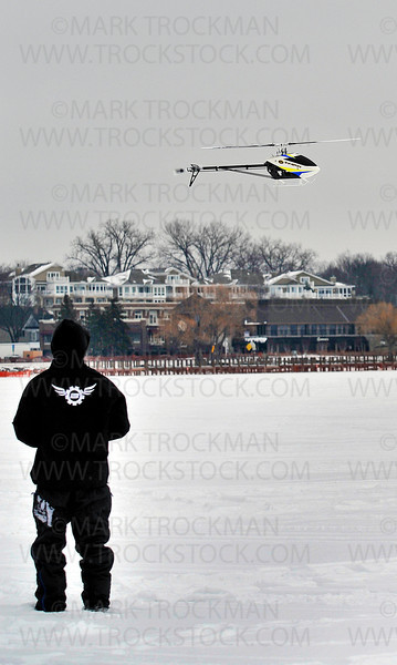 "Remote controlled helicopter pilot Rob Cherry, of Synergy Helicopters, also known as, 'Control Freaks', dazzles passers by with his expert moves during the 29th annual Chilly Open Saturday, Feb. 9 on Wayzata Bay.  The event is a unique frozen golf event to celebrate our ""chilly"" winter season."