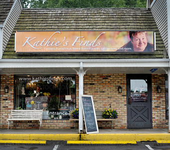 Kathie Armstrong's strong persona and exquisite attention to detail is reflected in the colorful sign above her business, Kathie's Finds, in Wayzata's East Village Wednesday, June 22, 2011.