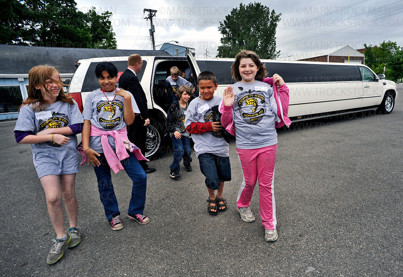 Hopkins School District elementary students from under-privileged living situations exit a huge Humvee limousine before entering Excel Boat Marina's facility on St. Albans Bay on Lake Minnetonka to get life jackets prior to setting out for a day on the lake as part of the Cops and Kids Fishing Event sponsored by the Hopkins Police Department Thursday, June 9, in Excelsior.