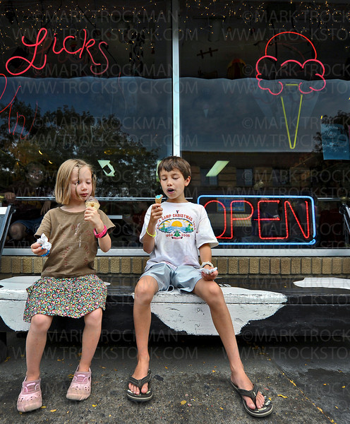 Harper Bemm, 5, and her brother Oliver, 11, enjoy their ice cream cones outside Licks Unlimited on a hot summer day in downtown Excelsior Thursday, August 30, 2012.