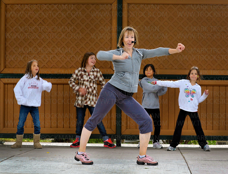 Ridgedale YMCA group exercise instructor Melinda Thein leads an impromptu session of Zumba dancing, a fusion of Latin and international music and dance, in the Bandshell in Downtown Park in Hopkins Saturday, Sept. 17.  Dancing behind Melinda Thein are, left to right, Kathryn Sherman, 9, Zoey Seurer, celebrating her 9th birthday, and eight-year-olds Lily McClelland, and Marissa Boettcher.