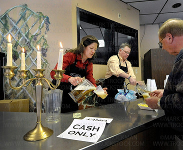 Barb Bito, left, and Guy Sprenger serve some of the last drinks at the old Wayzata Muni Thursday, April 28, in Wayzata.