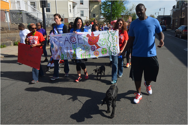 Ralph Parent (right) of Mattapan walks with his dog Cody.