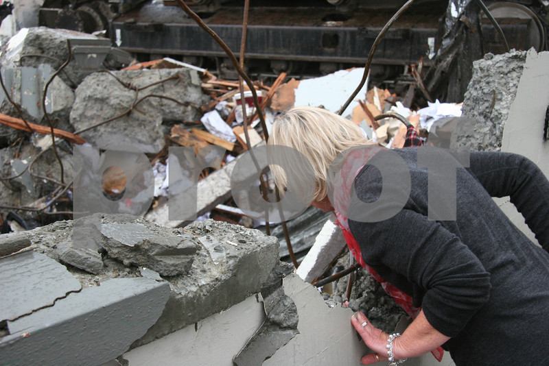 Traumatised and still in shock, yet 2 weeks on, an office worker returns to see the place where she worked. <br /> <br /> But this was in a peaceful country during a time of peace. But a series of earthquakes had reduced the city to rubble. It seemed like I had entered another war zone.<br /> <br /> <br /> <br /> Here an art-deco building occupied by motor vehicle repairers was utterly razed.<br /> <br /> I stood here saddened by all that lay before me.<br /> <br /> Just a little further on was the church in which 3 men died in the February quake as they were dismantling the pipe organ, for the church had been severely damaged in the earlier September quake and had to be demolished.<br /> <br /> Ahead I could see the casino, the hotels. Major hotels had just been assessed as needing to be demolished. A deep sadness engulfed me.<br /> <br /> Then a woman arrived to stand beside me. As she peered over this remaining piece of wall, she was looking into her former office, and there was her electric fan, her name on it, crushed in the pile of rubble. She hadn't wept in a week, but we did then.