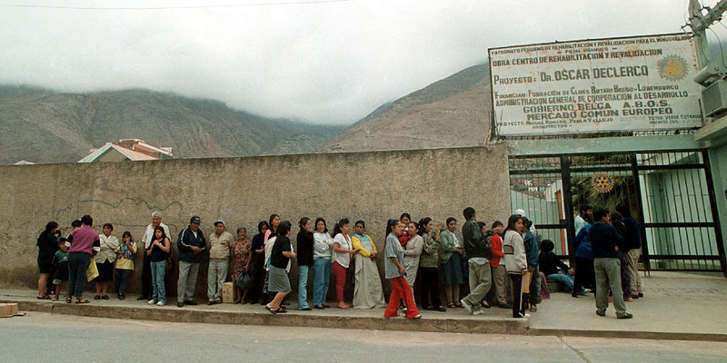 Photo by Bill Schaefer<br /> Without advance publicity people line up in the early morning under the fog shrouded mountains at the DeClercq Clinic in Huanuco, Peru on the first day that the medical personnel from southeast Idaho were there.
