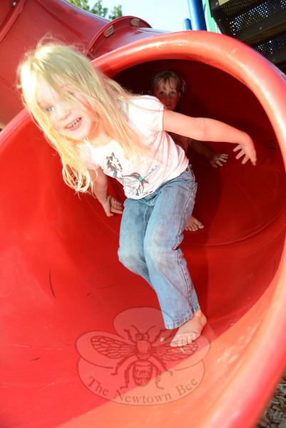 Ilse Popovic sneaks out of the tunnel slide and races for the swings at Treadwell Park on August 22. (Bobowick photo)