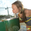 Nina Furrier balances an ice cream in her left hand while sipping from the water fountain at Tread-well Park on August 22. (Bobowick photo)