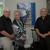 Artist Tony Woolner (left), artist Gayle Gleckler, and art show organizer Joe Mauro socialize during the opening reception last Sunday afternoon for Mr Woolner's and Ms Gleckler's art show which is now underway at The Inn at Newtown at 19 Main Street. The Newtown presentation is the fourth show where works by the married couple are being shown together. (Gorosko photo)