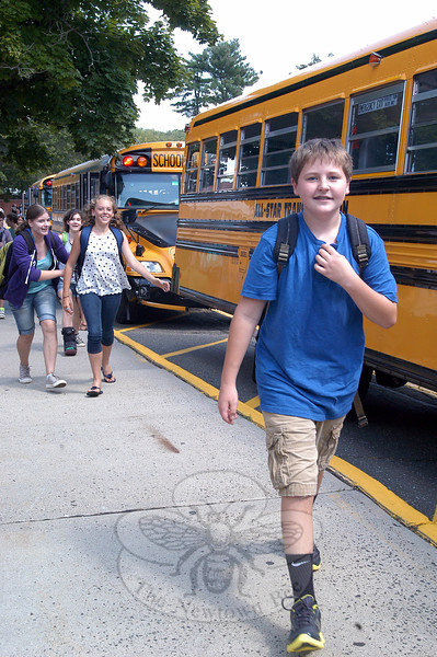 Newtown Middle School students made their way to their buses after the first day of school on Tuesday, August 28. (Hallabeck photo)