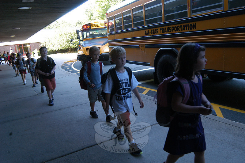 Students were mostly all smiles at the end of the first day of school on Tuesday, August 28, at Head O' Meadow School. (Hallabeck photo)
