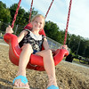 Scarlet Long cools off on the swing after a swim in the Treadwell Park pool on Wednesday, August 22. (Bobowick photo)