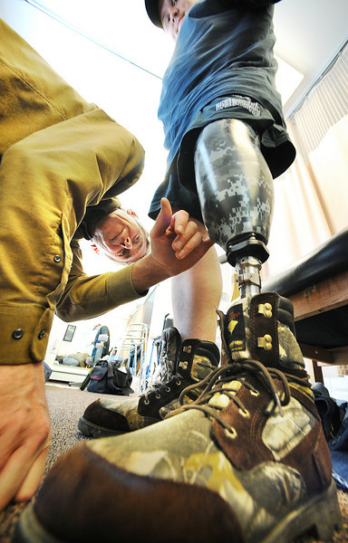 Glen DeCarteret, C.P. checks out a valve that needs to be tweeked on a  new prosthesis he made for Joshua Dyer of Waldoboro during a recent visit to the Lewiston office.