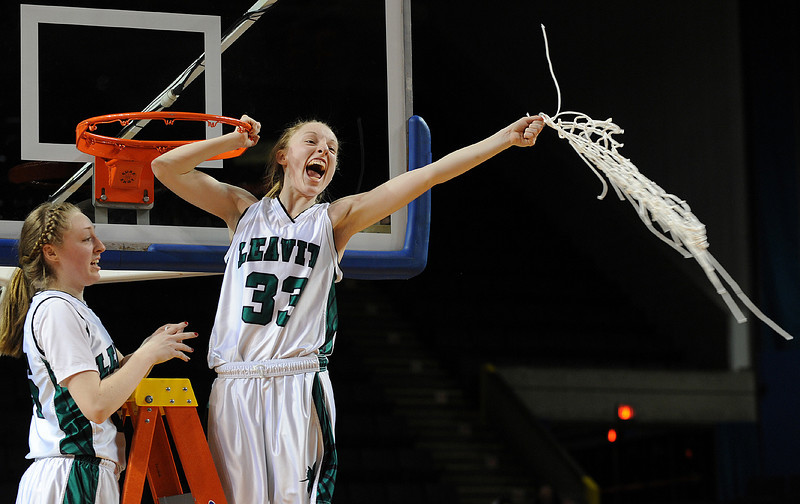Leavitt's Kristen Anderson, left and Courtney Anderson celebrate after Leavitt's 49-37 victory over Nokomis in the Class B State Championship girls basketball game