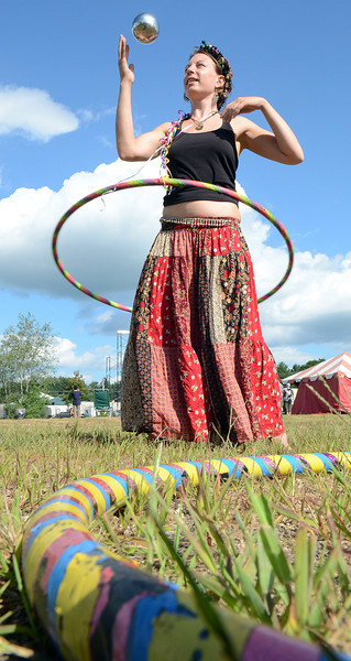 Jessica Splaine of Torrington Connecticut demonstrates her skills with some of the items for sale at the Try Out Toys tent on the edge of one of the four stages at Camp Creek in Oxford on Friday afternoon as the weekend long camping and music festival began.  For a video from Friday afternoon, visit sunjournal.com/campcreekfriday