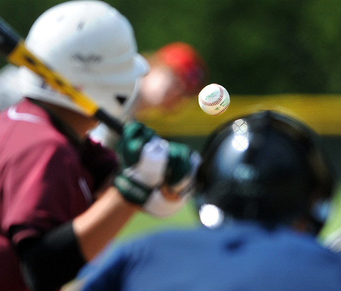 A Windham batter has a hard time focusing on the ball as Gayton Post 31 pitcher Ryan Riordan follows through on his delivery during the first game of a doubleheader at Windham Saturday morning.