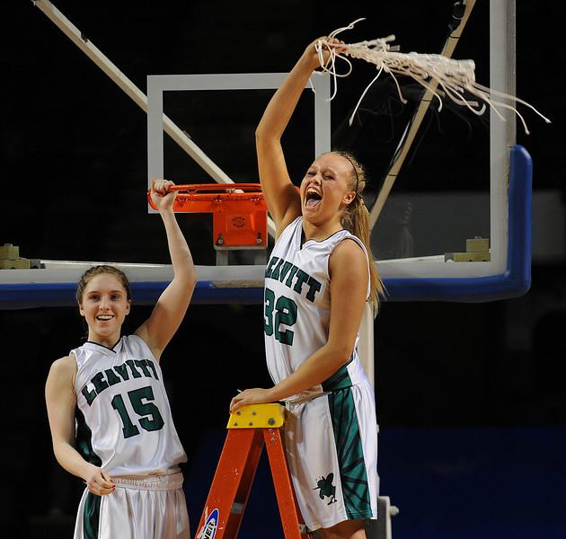 Leavitt's Abbey Randall, left and Adrianna Newton celebrate Leavitt's 49-37 victory over Nokomis in the Class B State Championship girls basketball game