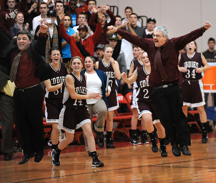Edward Little head varsity girls basketball coach Craig Jipson, right, and the rest of the team erupt at what they think is the end of the game during Monday night's KVAC championship game against Morse at Cony High School in Augusta.  The clock still had a few more ticks left on it, but the Eddies celebrated again for real moments later.
