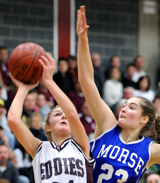 Edward Little's Ashlee Arnold drives to the basket for a layup, but Mikoline Ostergaard was there to swat the ball away druing Satruday night's game in Auburn.  Ostergaard was a dominating force under the basket as she helped the Shipbuilders swamp the Eddies 44-36.