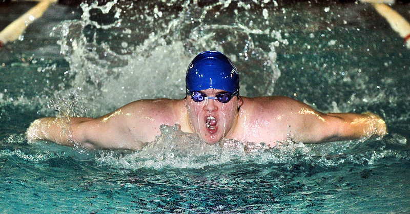 Lewiston's Ryan Pere churns the water as he compete's in the 100 yard butterfly during Firday's  meet against Belfast at the YWCA in Lewiston.