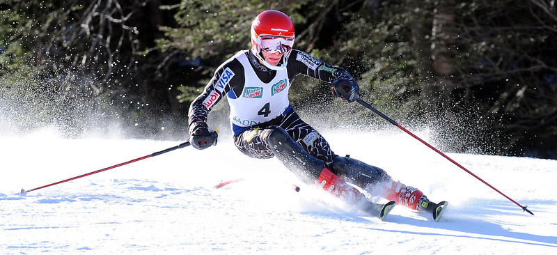 Alex Rose of Livermore Falls slaps a gate away as he cruises to an easy victory during Wednesday's Class C State Championship Slalom at Saddleback Mountain.