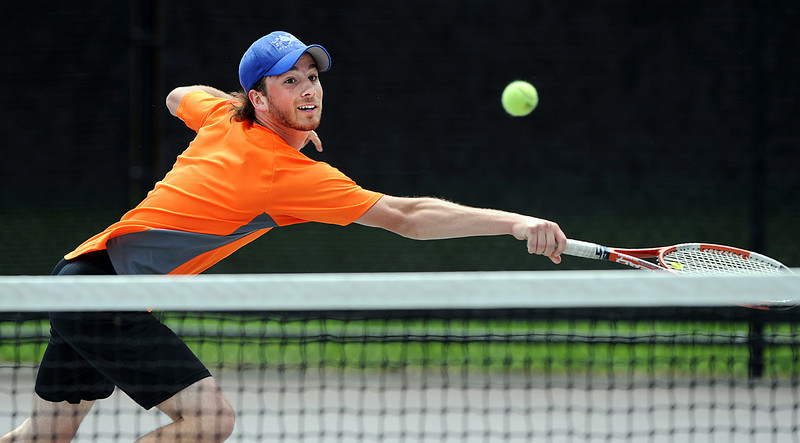 Scott Gagne of Lewiston High School stretches to reach a passing shot during Tuesday's match against Jordan Friedland in the Round of 16 in the state singles tournament being held at Bates College in Lewiston.  Gagne returned the ball into the net and lost the point and round of 16 match against Lincoln Academy's Jordan Friedland.