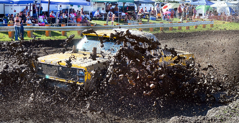 "An competitor is enveloped in mud as they try to make their way through the Deep Mud Saturday afternoon during the Firecracker4x4 at the Barnyard in Livermore.  Racing continues Sunday and a fun day is scheduled for Monday.  For a video of the fun, visit  <a href=""http://www.sunjournal.com"">http://www.sunjournal.com</a>"