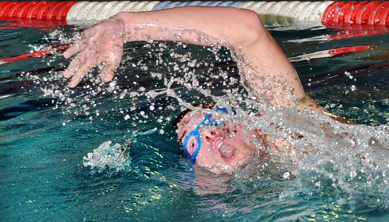 Lewiston's Colby Miles churns through the water as he compete's in the 500 yard freestyle during Friday night's swim meet against Belfast at the YWCA in Lewiston.