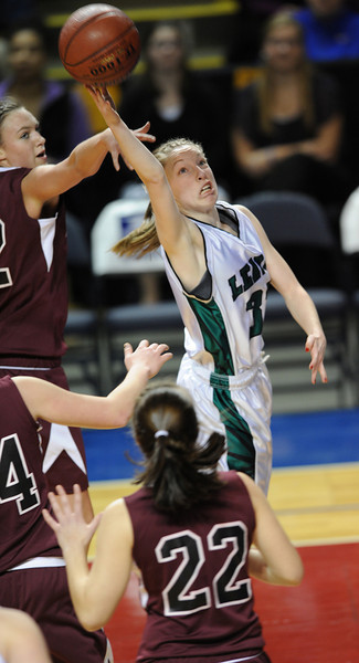 Leavitt's Courtney Anderson sneaks between several defenders to hit a layup during Friday night's 49-37 victory over Nokomis in the Class B State Championship girls basketball game