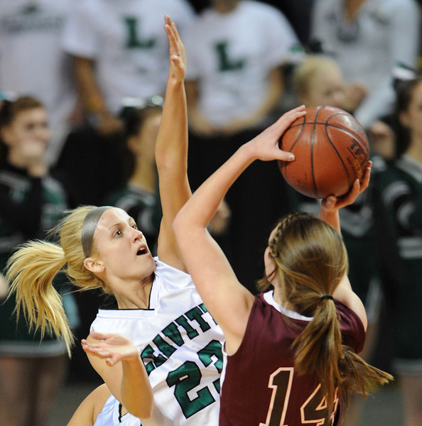 Leavitt's Amanda Jordan blocks a shot by Nokomis' Marissa Shaw during Leavitt's 49-37 victory over Nokomis in the Class B State Championship girls basketball game