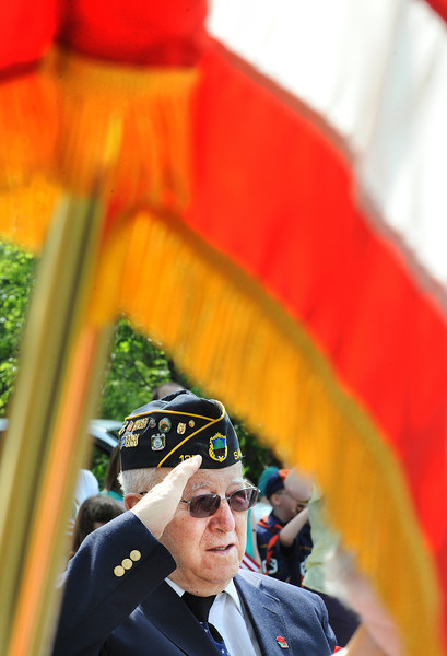 Joseph Breton of Sabattus, a 39 year veteran of the Coast Guard Reserves, salutes during the pledge of allegence during the Memorial Day Parade Monday morning in Sabattus.