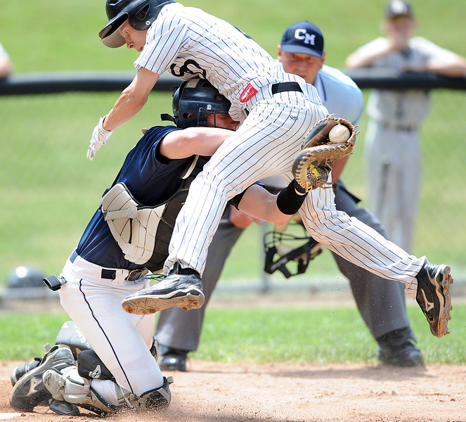 Saint Doms' Alex Parker is tagged out by Dirigo cathcer Justin Conant after Parker tried to score on a sharply hit ground ball by a teammate in the 5th inning of Monday's game in Auburn.