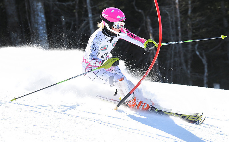Lindsey Jacques of Livermore Falls slaps a gate away as she cruises to an easy victory during Wednesday's Class C State Championship Slalom at Saddleback Mountain.