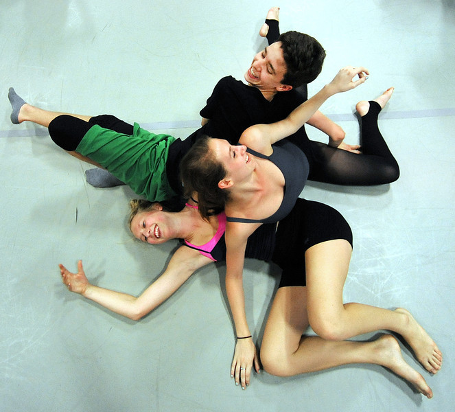"Johaann Evert of Austria, top, looks over at Sophie Maus of Virginia, middle, as they tumble over Taylor Seebold of California, bottom left, during their Improvisation class on Monday.  Nearly 100 aspiring dancers between 14-18 years old are taking part in the three week Young Dancers Workshop, part of the summer long Bates Dance Festival. For more information on the festival, visit  <a href=""http://www.batesdancefestival.org"">http://www.batesdancefestival.org</a>.  For a video from Monday's workshops, visit  <a href=""http://www.sunjournal.com"">http://www.sunjournal.com</a>"