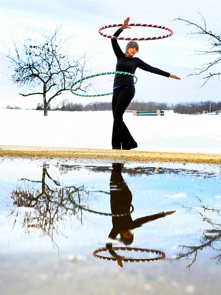"Carol Turner of Turner, dances in Veterans Memorial Park in Lewiston Saturday afternoon. The certified  dance instructor said she had extra energy after teaching a class in Maranacook and decided to come to dance for the veterans.  ""I like to come down here to honor them."""