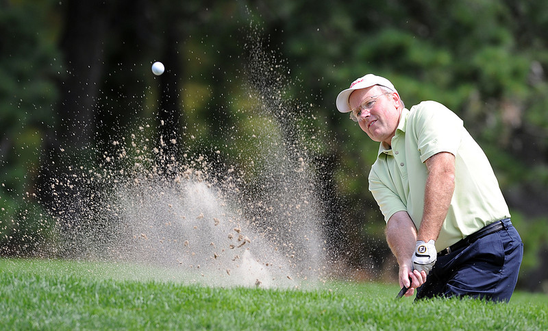 Keith Patterson blasts out of the bunker on the 15th hole during Wedensday's second round of the Maine Amateur.
