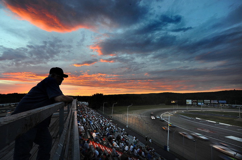 Martin McLaughlin of Norway watches one of races at Oxford Plains Speedway Friday night from the roof of the press box.